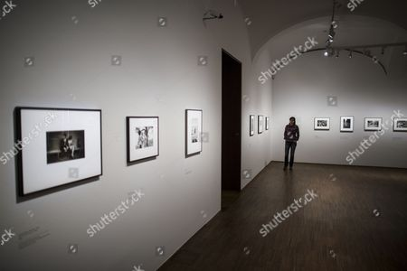 A visitor looks at photographs of Swiss-born photographer Robert Frank during a press preview of the exhibition 'Robert Frank' at the Galleries of Photography of the Albertina museum in Vienna, Austria, 23 October 2017. The exhibition Robert Frank will be open for public from 25 October 2017 until 21 January 2018.