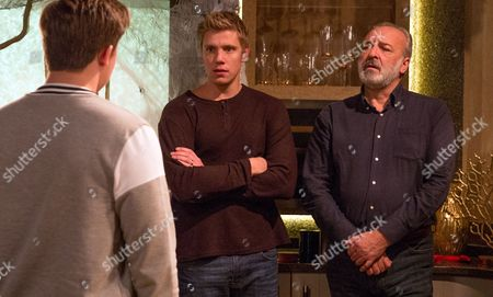 Stock Image of Ep 7975 Monday 30 October 2017 Robert Sugden, as played by Ryan Hawley, manipulates Lawrence White, as played by John Bowe, but Lachlan White, as played by Thomas Atkinson, interrupts as they're about to kiss. Lawrence demands Lachlan leaves the house, leaving Robert gloating.