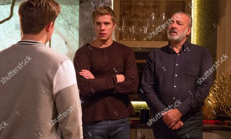 Ep 7975 Monday 30 October 2017 Robert Sugden, as played by Ryan Hawley, manipulates Lawrence White, as played by John Bowe, but Lachlan White, as played by Thomas Atkinson, interrupts as they're about to kiss. Lawrence demands Lachlan leaves the house, leaving Robert gloating.