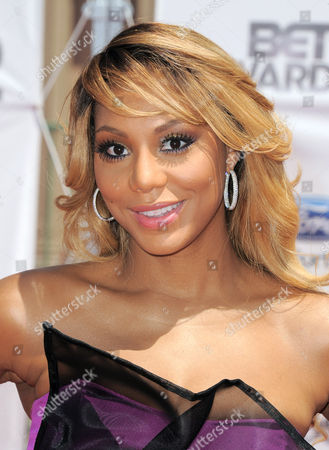 Tamar Braxton at the BET Awards in Los Angeles. Braxton debuted at No. 13 and No. 5 with Love & War on Billboard's R&B/Hip-Hop songs and R&B songs charts, respectively. The 35-year-old has been buzzing since a reality show starring her and her sisters premiered on WEtv last year. Her spotlight grew brighter when a spin-off with her husband Vincent Herbert _ who manages Lady Gaga _ kicked off this year