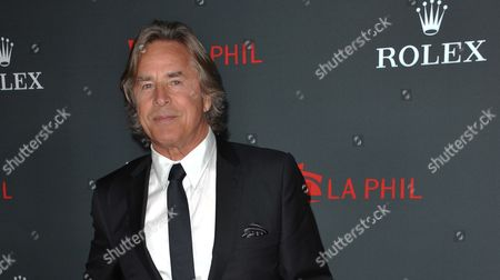 """Don Johnson arrives at the Los Angeles Philharmonic's 2012 Opening Night Gala, in Los Angeles. An appeals court on trimmed Johnson's $23.2 million verdict over """"Nash Bridges"""" profits down to $15 million plus interest after determining that jurors mistakenly awarded Johnson interest in their original verdict"""