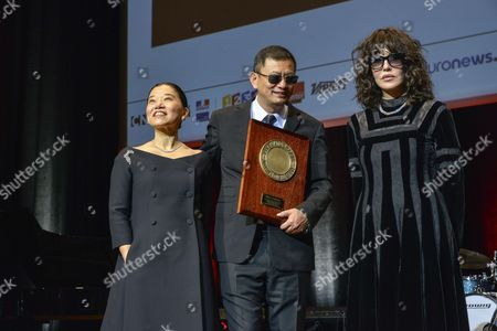 Kar Wai Wong and his wife Ye-Cheng and Isabelle Adjani