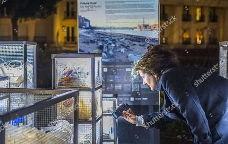 Artist Maria Arceo filming her installation, Future Dust at St. Katharine Docks