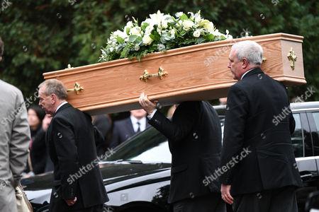 Sean Hughes coffin is carried in to Islington Crematorium