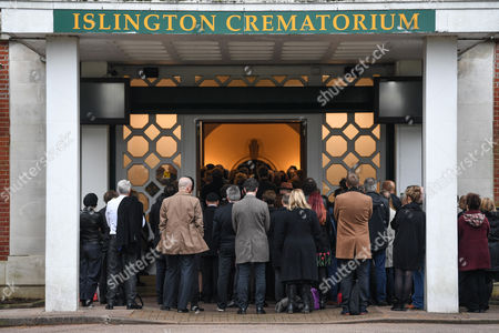 Mourners stand outside Islington Crematorium during Sean Hughes ' funeral