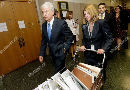 Stock Picture of San Francisco District Attorney George Gascon, left, walks with Deputy District Attorney Diana Garcia in a courthouse in San Francisco, . A murder trial started Monday for Jose Ines Garcia Zarate, a Mexican man who set off a national immigration debate after he shot and killed Kate Steinle on a San Francisco pier on July 1, 2015