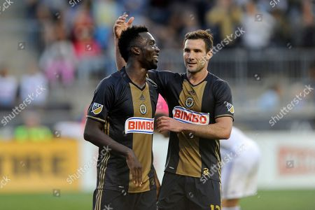 C.J. Sapong, Chris Pontius. Philadelphia Union's C.J. Sapong, left, and Chris Pontius are seen in action during an MLS soccer match against Orlando City, in Chester, Pa