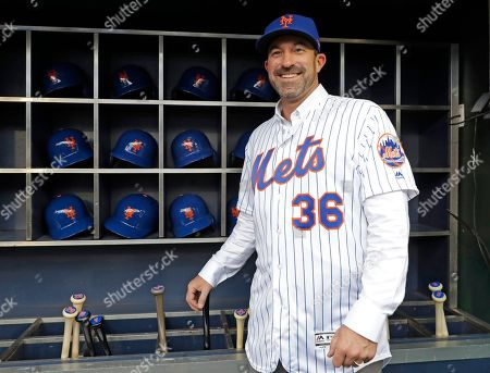Stock Image of New York Mets new manager Mickey Calloway poses for photographers in the dugout at CitiField after he was named to replace Terry Collins, in New York. Calloway comes to the Mets from the Cleveland Indians where he was a pitching coach