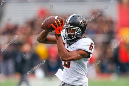 Stock Photo of Oklahoma State Cowboy corner back Adrian Baker (6) hauls in a catch before the game at Jones AT&T Stadium in Lubbock, Texas