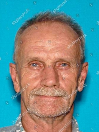 This undated driver's license photo provided by the Lake County Sheriff's Office shows Alan Ashmore, 61, of Clearlake Oaks, Calif. Deadly shootings, in a small lakeside Northern California community include at least one police officer, authorities said