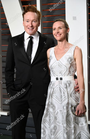 Conan O'Brien, left, and Liza Powel arrive at the Vanity Fair Oscar Party, in Beverly Hills, Calif