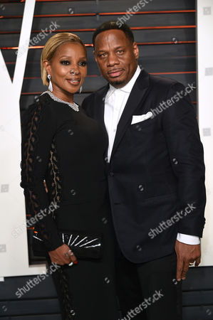 Stock Image of Mary J. Blige, left, and Kendu Isaacs arrive at the Vanity Fair Oscar Party, in Beverly Hills, Calif