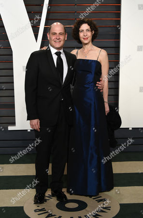 Matthew Weiner, left, and Linda Brettler arrive at the Vanity Fair Oscar Party, in Beverly Hills, Calif