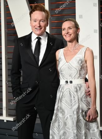 Conan O'Brien and wife Liza Powel O'Brien attend the Vanity Fair Fair Oscar Party at the Wallis Annenberg Center, in Beverly Hills, Calif
