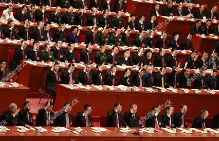 Chinese President Xi Jinping (front, C), Premier Li Keqiang (front 4-R), former Presidents Jiang Zemin (front, 5-R) and Hu Jintao (front, 5-L) raise their hands to vote during the closing ceremony of the 19th National Congress of the Communist Party of China (CPC) at the Great Hall of the People (GHOP) in Beijing, China, 24 October 2017.