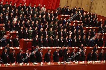 Chinese President Xi Jinping (front C), Premier Li Keqiang (front 6-R), former Presidents Jiang Zemin (front 7-R) and Hu Jintao (front 7-L) and other delegates stand during the closing ceremony of the 19th National Congress of the Communist Party of China (CPC) at the Great Hall of the People (GHOP) in Beijing, China, 24 October 2017. According to media reports on 24 October 2017, the National Congress of the Communist Party of China voted to enshrine the signature ideology of President Xi Jinping into the Chinese Communist Party constitution, elevating him to the country's most influential and powerful leader in decades. President Xi Jinping was also granted another five years in power during 19th Congress of the Communist Party of China.
