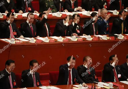 Chinese President Xi Jinping (front, C), Premier Li Keqiang (front, R), former Presidents Jiang Zemin (front, 2-R) and Hu Jintao (front, 2-L) raise their hands to vote during the closing ceremony of the 19th National Congress of the Communist Party of China (CPC) at the Great Hall of the People (GHOP) in Beijing, China, 24 October 2017.