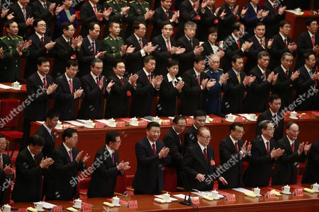 Chinese President Xi Jinping (4-C), Premier Li Keqiang (3-R), former Presidents Jiang Zemin (4-R) and Hu Jintao (3-L) clap during the closing ceremony of the 19th National Congress of the Communist Party of China (CPC) at the Great Hall of the People (GHOP) in Beijing, China, 24 October 2017. According to media reports on 24 October 2017, the National Congress of the Communist Party of China voted to enshrine the signature ideology of President Xi Jinping into the Chinese Communist Party constitution, elevating him to the country's most influential and powerful leader in decades. President Xi Jinping was also granted another five years in power during 19th Congress of the Communist Party of China.