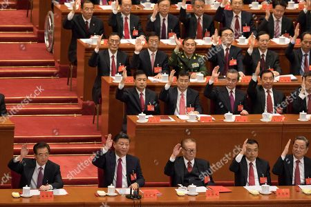 Hu Jintao, Xi Jinping, Jiang Zemin, Li Keqiang. From front row from left, former Chinese President Hu Jintao, Chinese President Xi Jinping, former Chinese President Jiang Zemin and Chinese Premier Li Keqiang lead other cadres to raise their hands to show approval of work reports during the closing ceremony for the 19th Party Congress held at the Great Hall of the People in Beijing, China