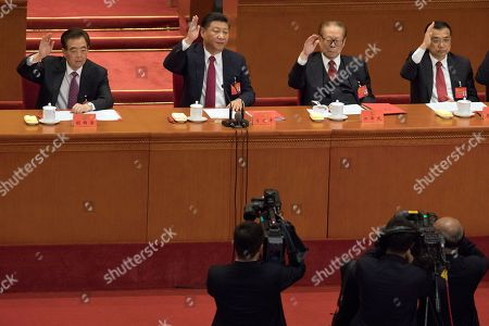 Hu Jintao, Xi Jinping, Jiang Zemin, Li Keqiang. From left, former Chinese President Hu Jintao, Chinese President Xi Jinping, former Chinese President Jiang Zemin and Chinese Premier Li Keqiang lead other cadres to raise their hands to show approval of work reports during the closing ceremony for the 19th Party Congress held at the Great Hall of the People in Beijing, China