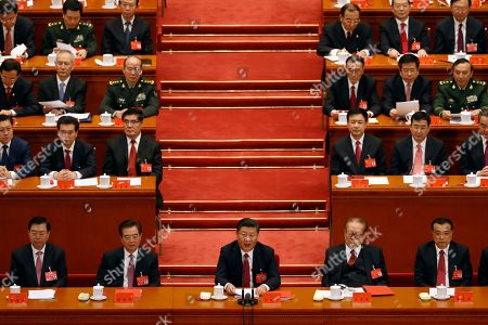 Xi Jinping, Hu Jintao, Jiang Zemin, Li Keqiang. Chinese President Xi Jinping, front row center, speaks next to former Chinese Presidents Hu Jintao, second from left, Jiang Zemin, second from right, and Chinese Premier Li Keqiang, right, during the closing ceremony for the 19th Party Congress held at the Great Hall of the People in Beijing, . China's ruling Communist Party moved Tuesday to confirm Xi Jinping's rise to becoming the country's most powerful leader in decades by amending its constitution to add his name and ideology