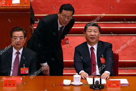 Xi Jinping, Hu Jintao. Chinese President Xi Jinping, right, chats with his aide next to former President Hu Jintao, left, during the closing ceremony for the 19th Party Congress at the Great Hall of the People in Beijing