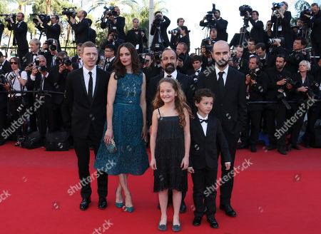 Producer Alexandre Mallet-Guy, left, actress Berenice Bejo, director Asghar Farhadi, second from right in back, actor Ali Mosaffa, back right, actress Jeanne Jestin, front left, and actor Elyes Aguis, front right, pose for photographers as they arrive for the awards ceremony of the 66th international film festival, in Cannes, southern France