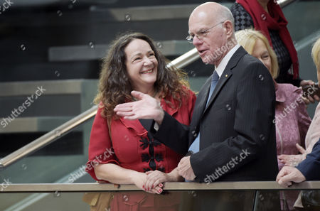 The former President of the German Parliament, Norbert Lammert (R), speaks with an unidentified woman during the constituent meeting at the Bundestag in Berlin, Germany, 24 October 2017. The newly elected German Bundestag holds its constituent meeting of Parliament in its 19th electoral period. The meeting will be opened with a speech by the chairman by seniority followed by the election of the President of the Bundestag and the other members of the Presidium, as well as the decision on the agenda of the German Bundestag.