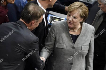 German Chancellor Angela Merkel (R) of the Christian Democratic Union (CDU) congratulates the newly elected vice president of the German Parliament of the Social Democratic Party (SPD), Thomas Oppermann, during the constituent meeting at the Bundestag in Berlin, Germany, 24 October 2017. The newly elected German Bundestag holds its constituent meeting of Parliament in its 19th electoral period. The meeting will be opened with a speech by the chairman by seniority followed by the election of the President of the Bundestag and the other members of the Presidium, as well as the decision on the agenda of the German Bundestag.
