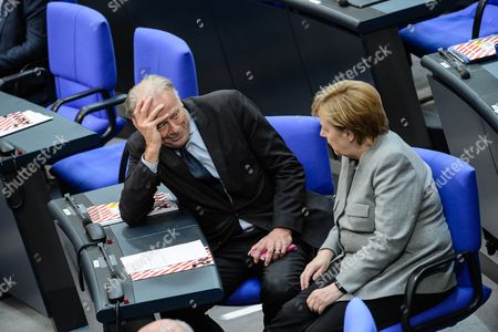 German Chancellor Angela Merkel (R) and Former German Minister Juergen Trittin (L) during the constituent meeting of the German 'Bundestag' parliament, in Berlin, Germany, 24 October 2017. Others are not identified. The newly elected German Bundestag holds its constituent meeting of Parliament in its 19th electoral period. The meeting will be opened with a speech by the chairman by seniority followed by the election of the President of the Bundestag and the other members of the Presidium, as well as the decision on the agenda of the German Bundestag.