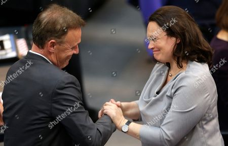 Thomas Oppermann, left, candidate of the Social Democratic Party for Vice President of the German parliament, is congratulated by Social Democratic faction leader Andrea Nahles after being elected as deputy parliament president during the first meeting of the German parliament after the election in Berlin, Germany