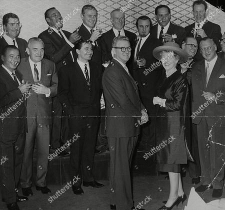 Fifteen Top Band Leaders Had Lunch At The Savoy On The Retirement Of Jim Davidson Assistant Head Of Light Entertainment At The Bbc. Back Row: Victor Sylvester (4th Left) Acker Bilk And Edmundo Ros. Front Row L-r: Joe Loss Unknown Kenny Ball Jim Davidson And Wife. Box 773 92007179 A.jpg.