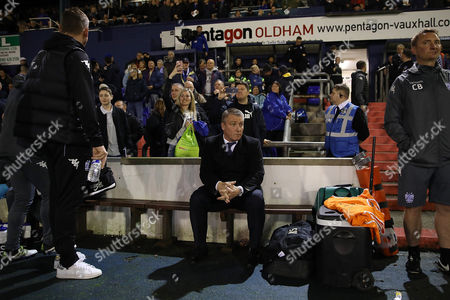 Stock Picture of Lee Clark, Manager of Bury sits in the dugout