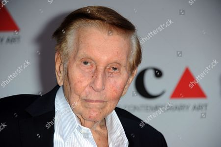 Stock Photo of Media mogul Sumner Redstone arrives at the 2013 MOCA Gala celebrating the opening of the Urs Fischer exhibition at MOCA, in Los Angeles. Los Angeles Superior Court Judge David J. Cowan, dismissed a case challenging the mental competency of Redstone, saying testimony from the media mogul that he wanted his former girlfriend out of his life was convincing