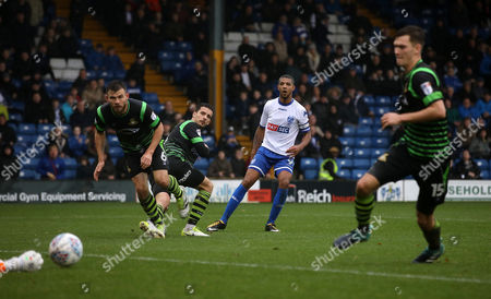 Jermaine Beckford of Bury gets a shot away
