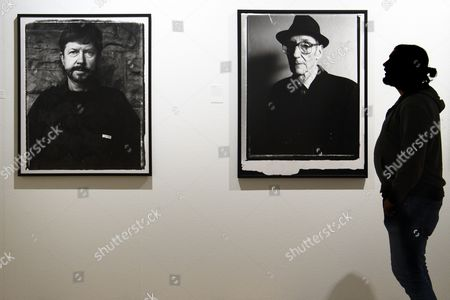 A visitor looks at photos of US artist William S. Burroughs (R) and American novelist Tom Robbins (L) taken by US director Gus Van Sant inside the exhibition 'Gus Van Sant-Icons' at the Musee de l'Elysee in Lausanne, Switzerland, 24 October 2017. Van Sant exhibits his paintings, photographs, music videos and films from 25 October 2017 to 07 January 2018.