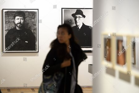 A visitor walks through next to photos of US artist William S. Burroughs (R) and American novelist Tom Robbins (L) taken by US director Gus Van Sant inside the exhibition 'Gus Van Sant-Icons' at the Musee de l'Elysee in Lausanne, Switzerland, 24 October 2017. Van Sant exhibits his paintings, photographs, music videos and films from 25 October 2017 to 07 January 2018.