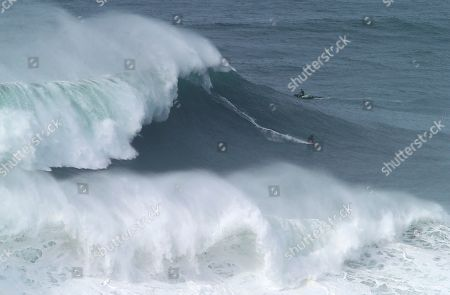 Brazilian surfer Maya Gabeira rides a wave during a big wave surfing session at the Praia do Norte, or North beach, in Nazare, Portugal
