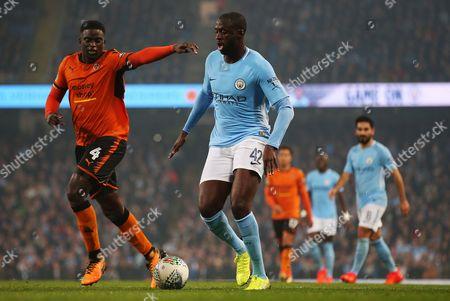 Yaya Toure of Manchester City takes on Alfred N'Diaye of Wolverhampton Wanderers