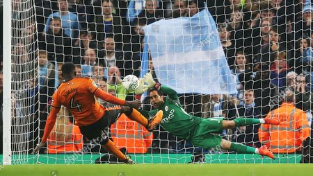 Claudio Bravo of Manchester City saves a penalty taken by Alfred N'Diaye of Wolverhampton Wanderers