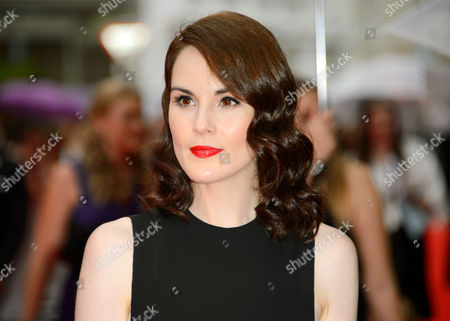 Stock Picture of Michelle Dockery arrives for theBAFTA Celebrates Downton Abbey event in London. Dockery's fiance John Dineen, died Sunday, Dec. 13, at a hospice in Cork, Ireland. He was 34