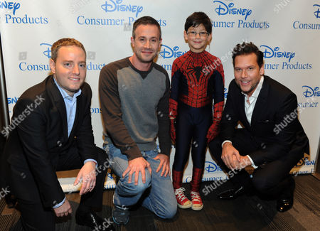 Josh Silverman, left, Executive Vice President, Disney Consumer Products, Freddie Prinze. Jr, second left, voice of Kanan on the upcoming animated TV series Star Wars Rebels,' Jorge Vega, second right, in The Amazing Spider-Man 2, and actor Dane Cook, right, voice of Dusty Crophopper in Disney's animated film Planes: Fire and Rescue, help Disney Consumer Products unveil an innovative assortment of toys inspired by their content, at the American International Toy Fair in New York
