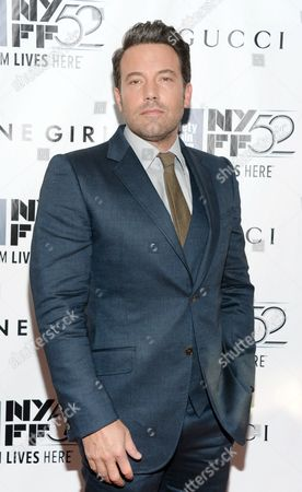 """Ben Affleck arrives at 2014 NYFF - """"Gone Girl"""" opening night world premiere, in New York. Affleck and David Fincher are reteaming for a remake of Alfred Hitchcock's Strangers on a Train. On the heels of their 2014 box-office hit """"Gone Girl,"""" the star and the director will reunite for a film based on the 1951 classic in which two strangers meet on a train and conspire to carry out murders for one another"""