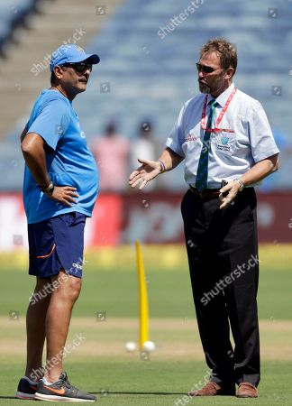 Chris Broad, Ravi Shastri. Match referee Chris Broad, right, interacts with Indian team coach Ravi Shastri before the start of second one-day international cricket match between India and New Zealand in Pune, India