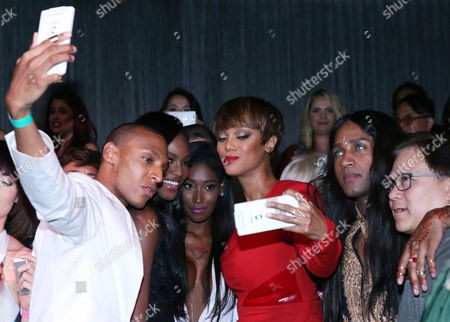 Stock Picture of IMAGE DISTRIBUTED FOR OPPO - Tyra Banks, center, takes a selfie with executive producer Ken Mok, right, and America's Next Top Model Cycle 22 contestants using the OPPO N3 at the show's premiere party in Los Angeles on . OPPO, a leading global smartphone brand, is featured throughout ANTM's cycle 22 set to air August 5 on the CW network