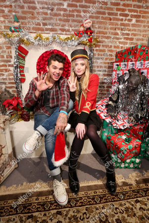 IMAGE DISTRIBUTED FOR PARAMOUNT HOME ENTERTAINMENT - Andrew Jacobs and Kathryn Newton from Paranormal Activity 4 and 5 at the Blumhouse haunted holiday party in celebration of the digital HD release The Ghost Dimension on Thurs., in Los Angeles