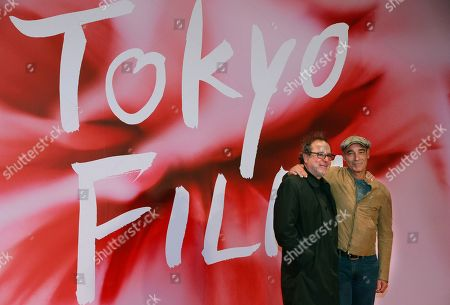 Semih Kaplanoglu, Jean-Marc Barr. Turkey Director Semih Kaplanoglu, left, and actor Jean-Marc Barr pose for photographers during the opening ceremony of the Tokyo Film Festival in Tokyo