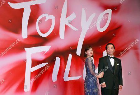 Tsubasa Honda, Fumihiko Sori. Japan's actress Tsubasa Honda, left, and director Fumihiko Sori pose for photographers during the opening ceremony of the Tokyo Film Festival in Tokyo