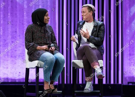 Abby Wambach, right, talks with Ibtihaj Muhammad onstage at Together Live at the Chicago Theatre on in Chicago