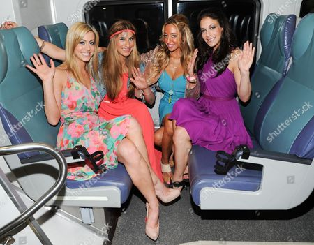 """The cast of Bravo's """"Princesses: Long Island"""", from left, Casey Cohen, Chanel """"Coco"""" Omari, Amanda Bertoncini and Joey Lauren pose together at Penn Station before they depart for The Hamptons on in New York"""